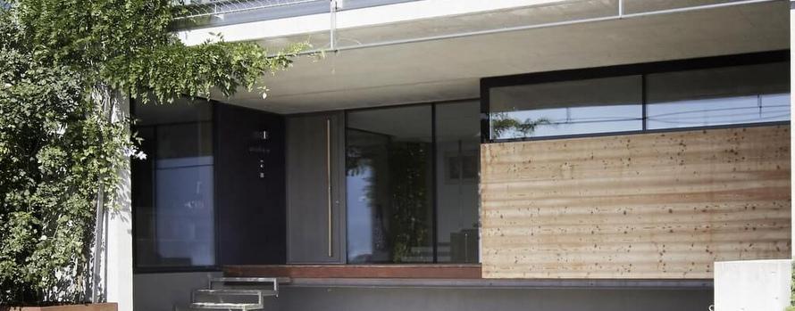 Elmer Ganzglasfassade Eingang